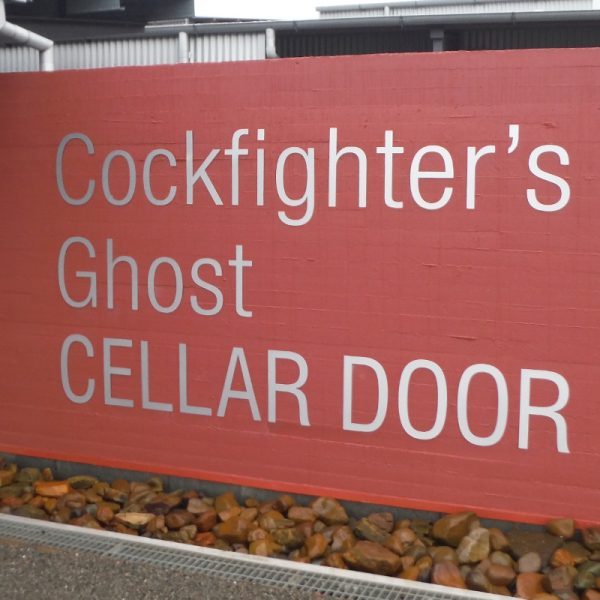 Sign showing the name of a Wine Bar called the Cockfighters Ghost Cellar Door on the